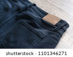 back of jeans on wood... | Shutterstock . vector #1101346271