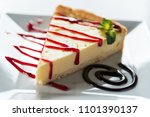triangular piece of cheesecake... | Shutterstock . vector #1101390137