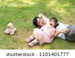 asian father and daughter are... | Shutterstock . vector #1101401777