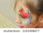 a little girl with aqua grim on ... | Shutterstock . vector #1101408677