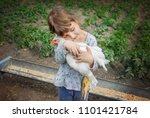bio chickens on a home farm  a... | Shutterstock . vector #1101421784