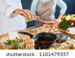close up of male chef pouring... | Shutterstock . vector #1101479357