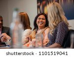 two businesswomen talking while ... | Shutterstock . vector #1101519041