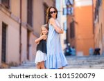 happy mother and little... | Shutterstock . vector #1101520079