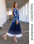 Small photo of Stylish beautiful girl in designer clothes. She wore a tunic. It is made in the technology of nunovolok on white rarefied silk of merino wool, decorated with viscose fibers