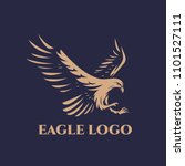 Stock vector the flying eagle on dark background eagle logo template 1101527111