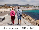 couple walking the dale of the... | Shutterstock . vector #1101541631