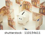 Piggy coin bank in money labyrinth - stock photo