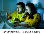 young couple looking a bad game ... | Shutterstock . vector #1101565391