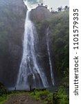 Misty Manawaiopuna Falls Hawai...