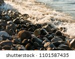 waves hit to the stones on the... | Shutterstock . vector #1101587435