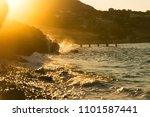 stony beach with waves and with ... | Shutterstock . vector #1101587441
