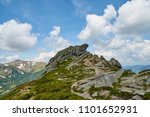 Small photo of Big stone scaur in Carpathian mountains with the blue sky and white clouds in the summer