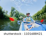 happy boy kayaking with his...   Shutterstock . vector #1101688421