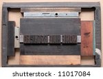 a printer's chase holds wood type ready for the press - stock photo