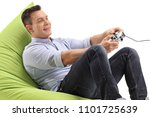 young man sitting on a beanbag... | Shutterstock . vector #1101725639