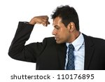 Indian business man flexing his bicep. Concept about power and strength. - stock photo