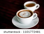 coffee cup on wooden table.... | Shutterstock . vector #1101772481