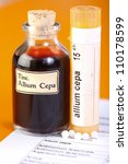 Small photo of Allium Cepa plant extract. Mother tincture and homeopathic pills on sheet