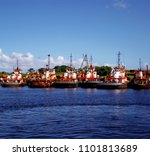 fleet of tug boats parked on... | Shutterstock . vector #1101813689