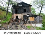 Small photo of The burned-down abandoned barrack.
