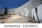 BETHLEHEM, OCCUPIED PALESTINIAN TERRITORIES - JUNE 19: Activist graffiti adorns the Israeli separation wall in the West Bank town of Bethlehem on June 19, 2011. - stock photo