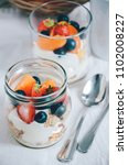 fresh berries and fruits with... | Shutterstock . vector #1102008227