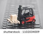 forklift miniature with wooden... | Shutterstock . vector #1102034009