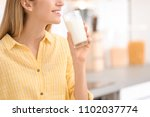 beautiful young woman drinking... | Shutterstock . vector #1102037774