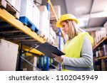 woman warehouse worker with... | Shutterstock . vector #1102045949