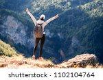 female backpacker exploring... | Shutterstock . vector #1102104764