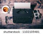 3d typewriter on wooden ... | Shutterstock . vector #1102105481