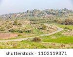 ascending winding narrow road...   Shutterstock . vector #1102119371