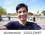 asian man take photo selfie in... | Shutterstock . vector #1102122497