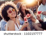 cheerful young friends eating... | Shutterstock . vector #1102157777