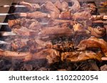closeup of kebab ribs cooked on ... | Shutterstock . vector #1102202054