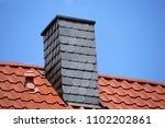 new tiled roof with chimney... | Shutterstock . vector #1102202861
