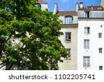 typical parisian houses  in the ... | Shutterstock . vector #1102205741