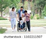 happy elderly woman talking... | Shutterstock . vector #1102211507