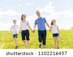 family of four outdoors in a... | Shutterstock . vector #1102216457