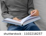man reading interesting book at ... | Shutterstock . vector #1102218257