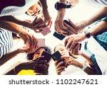 diverse friends using their... | Shutterstock . vector #1102247621