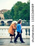 Small photo of ROME, ITALY. May 06, 2015: Three women in the street on a bridge in the center of the city of Rome, Italy. Three ladies strolling with elderly. Outdoor, elder care.