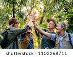 senior trekkers giving a high... | Shutterstock . vector #1102268711