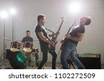 rock and roll band guitarists... | Shutterstock . vector #1102272509