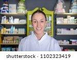 pharmacist chemist woman... | Shutterstock . vector #1102323419