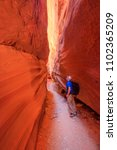 hiking in a remote slot canyon  ... | Shutterstock . vector #1102365209