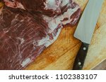 Small photo of Delicious raw thick skirt steak, in the wooden board. Argentine court very consumed in barbecues. Close up