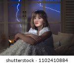 the face of a frightened young... | Shutterstock . vector #1102410884