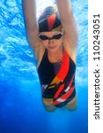 professional female sport master smiling underwater - stock photo
